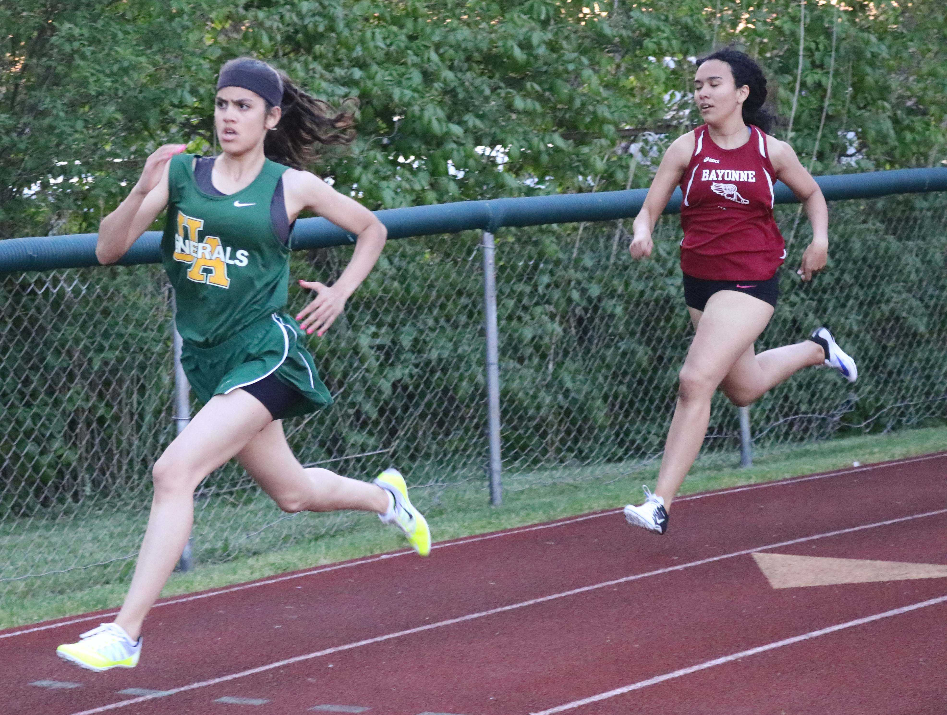 Freshmen Michael Tapalla (top) and Tiffany Ortiz (bottom) run in the 400-meter at the Husdon County Track Coach Association Championships. The freshmen have been a highlight of the spring track season. Photo by Angel Guzman