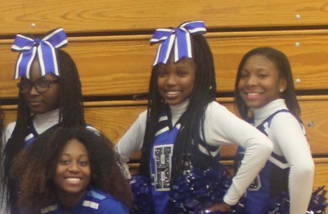 UACHS seniors Ajah Ricardo, Thara Dambreville and Imani White pose with other Lincoln cheerleaders. Several UACHS students cheer for other high schools that have cheerleading teams. Photo by Tatyana Reed
