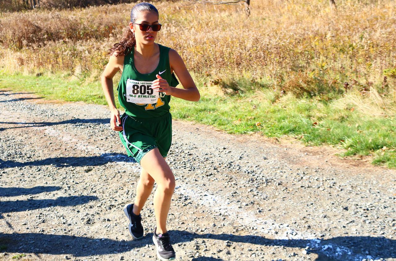 Sophomore Tiffany Ortiz is on her final stretch to finish 10th in the girls NJSIAA Sectionals North II meet. Ortiz qualified for the NJSIAA Meet of The Champions as a sophomore but didn't finish the race. Photo by Angel Guzman