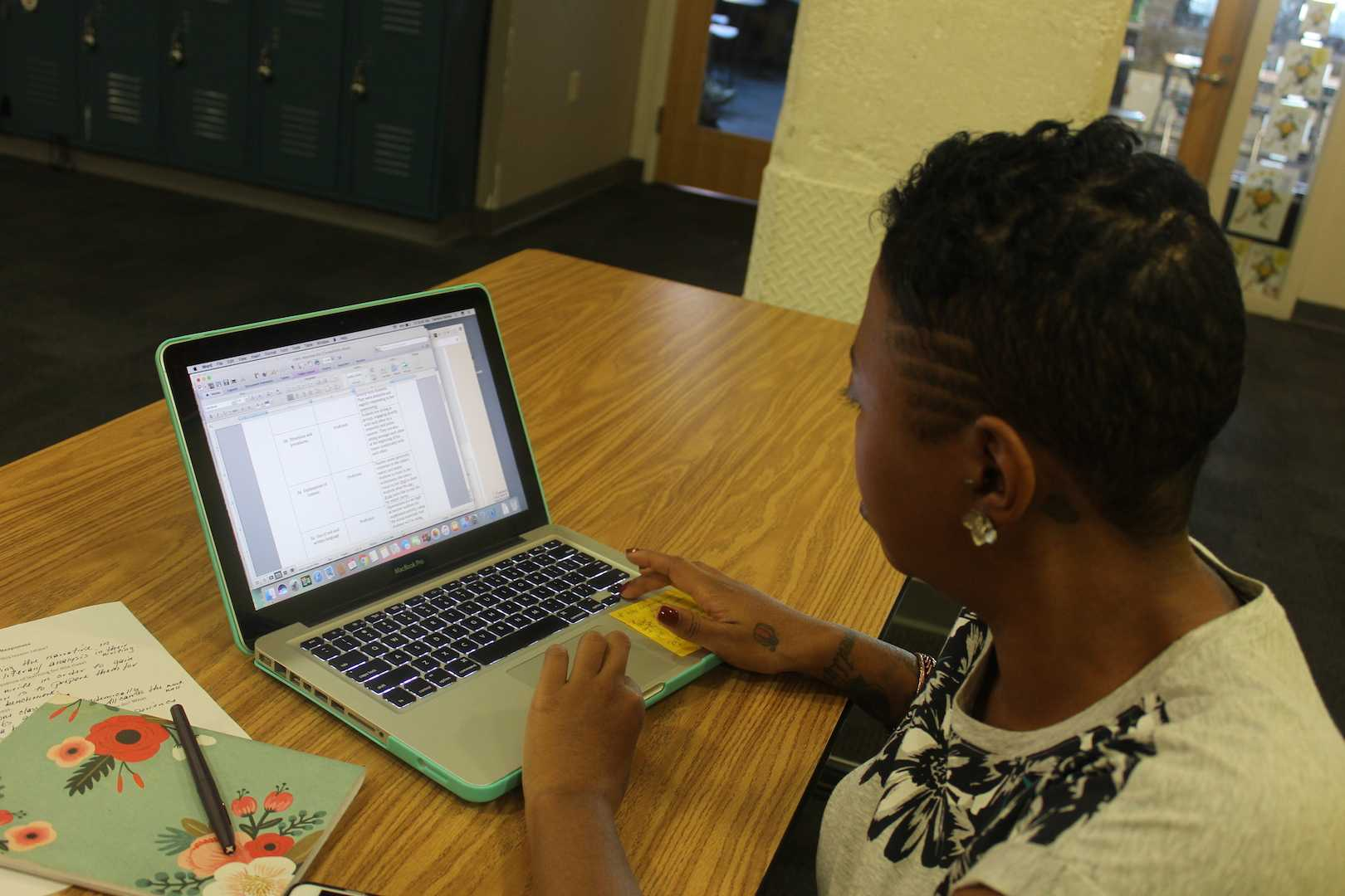 English teacher Darlene Rainey works on an assignment for one of her NJCU graduate classes. Several teachers have gone back to school this year
