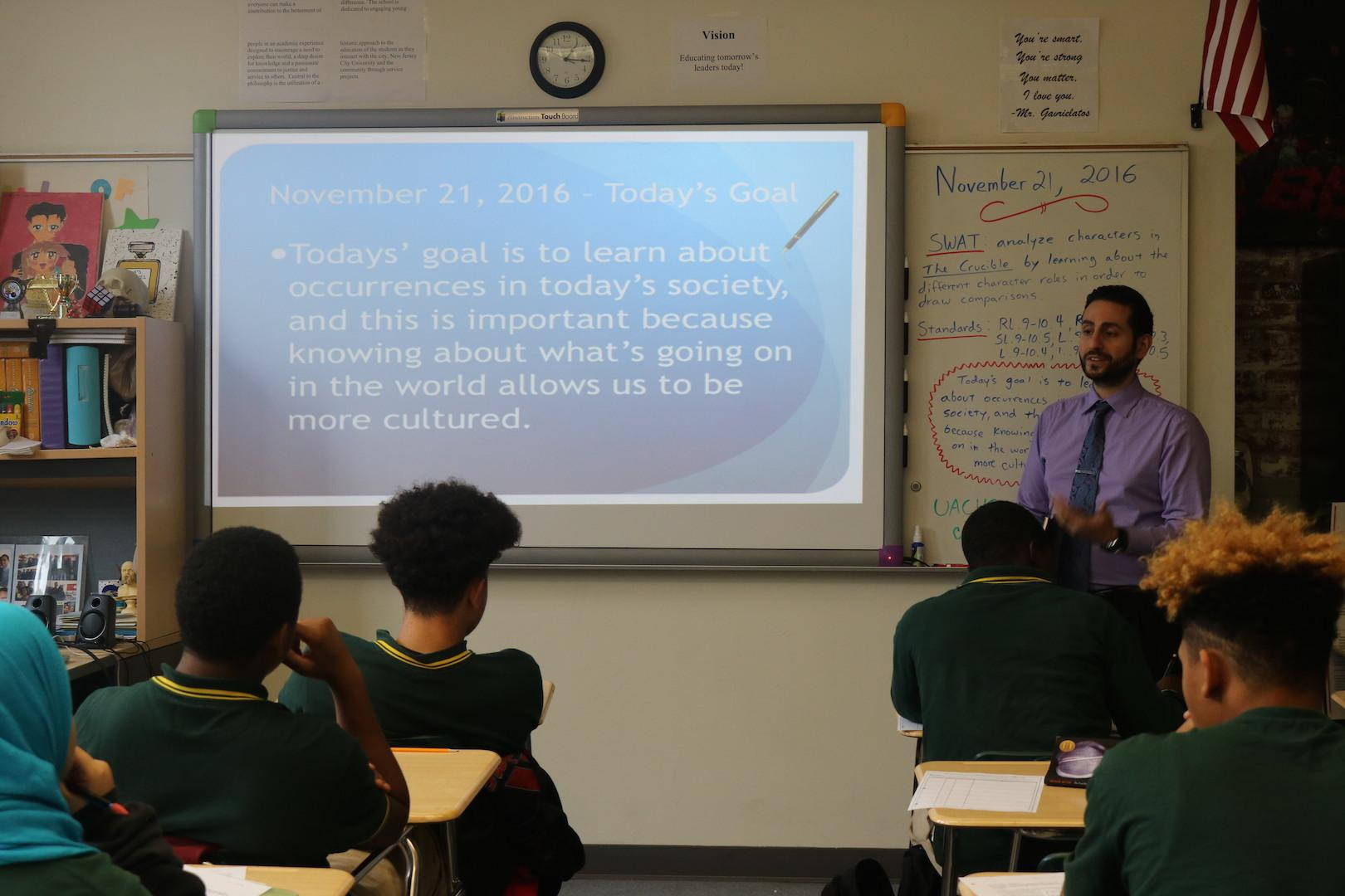 English teacher Steven Gavrielatos shows his class the meaning statement of the day. Teachers are doing so to emphasize the importance of each lesson. Photo by Infinity Ferguson
